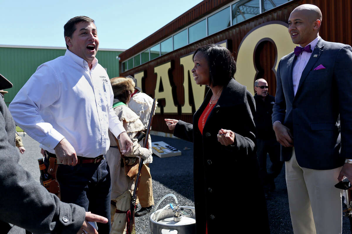 Mayor Ivy Taylor expresses her readiness to try a beer with Alamo Beer Co. president Eugene Simor, left, and City Councilman Alan E. Warrick II, right, during the Alamo Beer Company Brewery, Beer Hall and Beer Garden Grand Opening on Friday, March 6, 2015.
