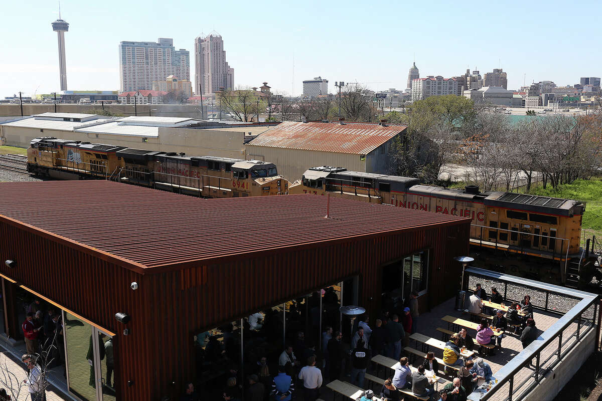 Patrons wait in line and fill the beer garden and beer hall during the Alamo Beer Company Brewery, Beer Hall and Beer Garden Grand Opening on Friday, March 6, 2015.