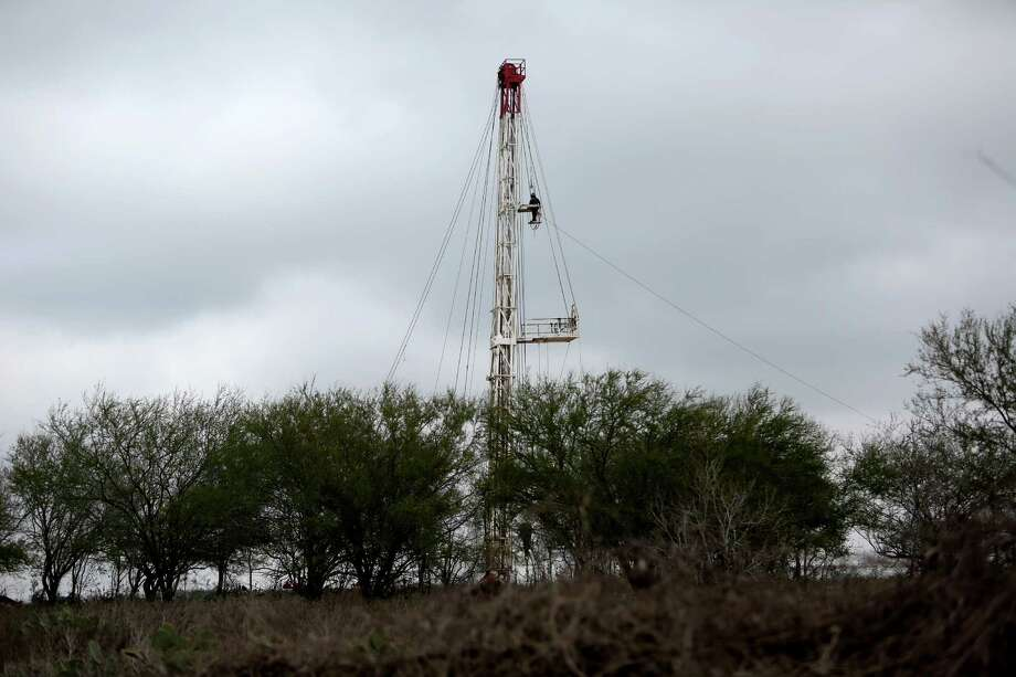 A worker climbs an EOG Resources oil rig in South Texas' Eagle Ford Shale. The Houston company predicts double-digit production growth   if oil prices stabilize at $65 a barrel.  (Gary Coronado / Houston Chronicle ) Photo: Gary Coronado, Staff / © 2015 Houston Chronicle