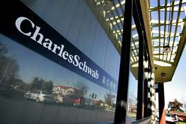 "A sign at Charles Schwab financial branch office in Cupertino, Calif., Wednesday, Jan. 17, 2007. The sign in Chinese means, ""Charles Schwab financial management"". Charles Schwab Corp.'s fourth-quarter earnings more than doubled to lift the stock brokerage's annual profit above $1 billion for the first time in its history.   (AP Photo/Paul Sakuma) Ran on: 01-18-2007 Charles Schwab offices, like this one in Cupertino, had enough transactions to send the company's 2006 earnings past $1 billion. Ran on: 07-18-2007 An office in Cupertino carries Chinese characters reading &quo;Charles Schwab financial management.&quo;"