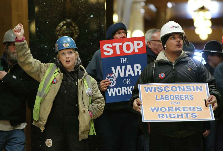 Mary Will, left, with Local 68, and Corey Smith, right, with Local 113, chant 'Union Strong' during a rally inside the Wisconsin State Capitol as the state Assembly debates the right-to-work bill in Madison, Wis., Thursday, March 5, 2015. (AP Photo/Wisconsin State Journal, Amber Arnold) Photo: Amber Arnold, MBO / Wisconsin State Journal