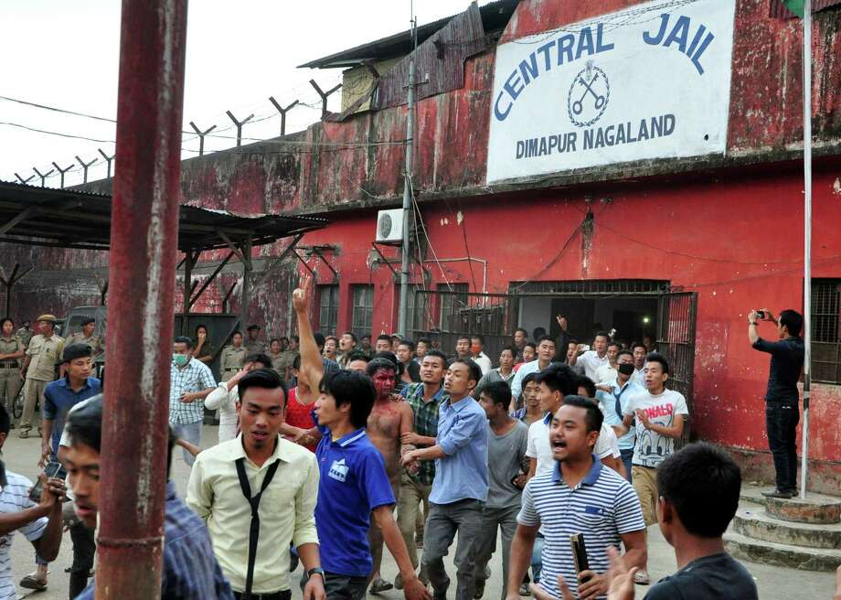Mob pulls bloodied, shirtless rape suspect Syed Sirf Khan from a jail in Dimapur, Inda on Thursday. Photo: STR / AP
