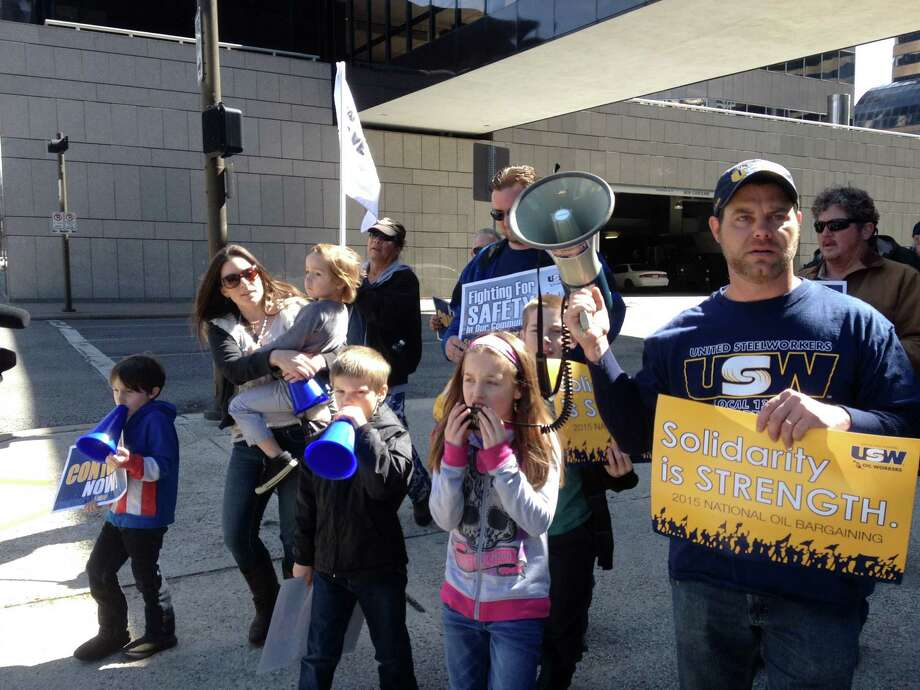 The family of Justin and Heather Webb take part in a union protest earlier this month at LyondellBasel's downtown headquarters. A Steelworkers' strike involved LyondellBasell's Houston plant.  Photo: Sarah Scully