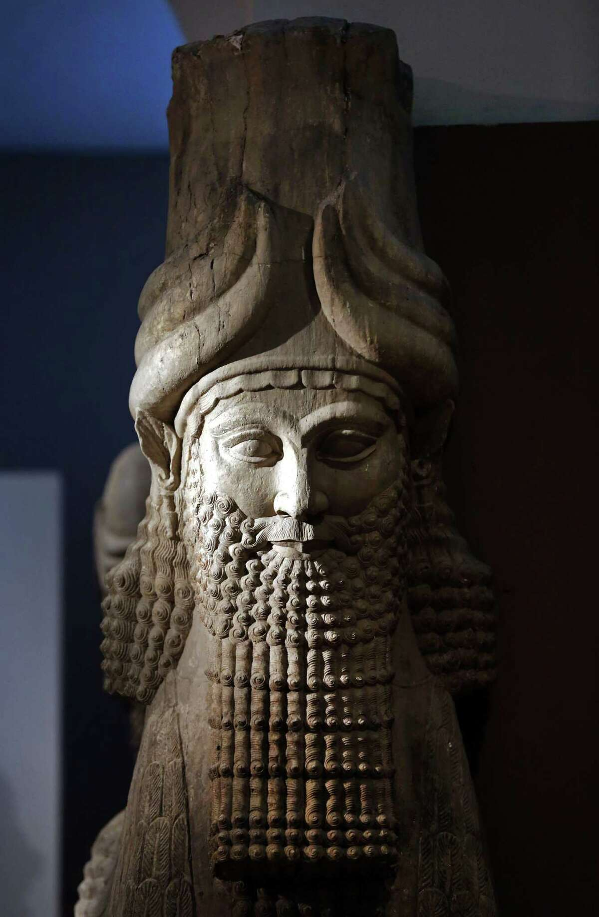 FILE - This Monday, Sept. 15, 2014 file photo shows a detail of a statue from the Assyrian period displayed at the Iraqi National Museum in Baghdad. Islamic State militants
