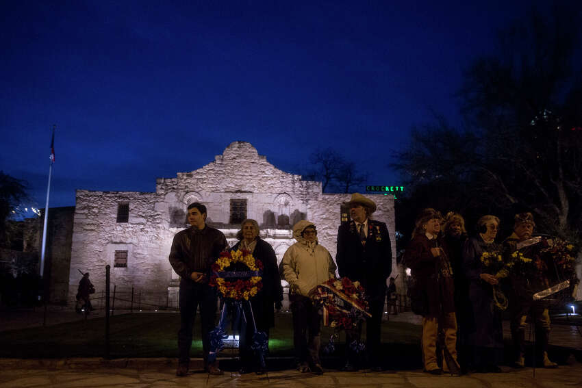 Descendents of Alamo defenders stand in front of the crowd holding floral wreaths during the annual Dawn at the Alamo ceremony in San Antonio, TX on Friday, March 6, 2015. This year marks the 179th anniversary of the predawn battle.