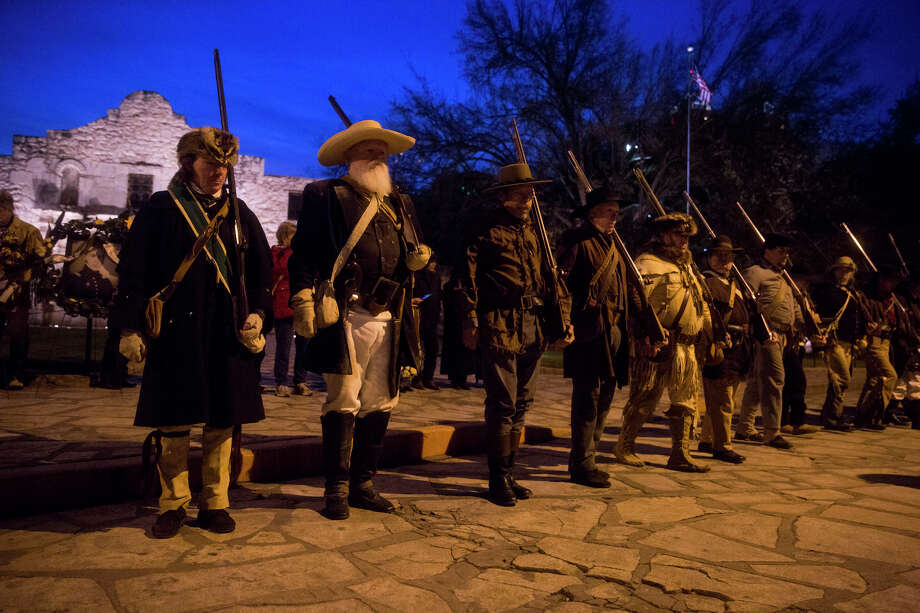 Historical reenactors from all over Texas and the U.S. walk in formation during the annual Dawn at the Alamo ceremony in San Antonio, TX on Friday, March 6, 2015.  This year marks the 179th anniversary of the predawn battle.  The reenactors were brought to the ceremony by the San Antonio Living History Association. Photo: Carolyn Van Houten, Staff / San Antonio Express-News / 2015 San Antonio Express-News