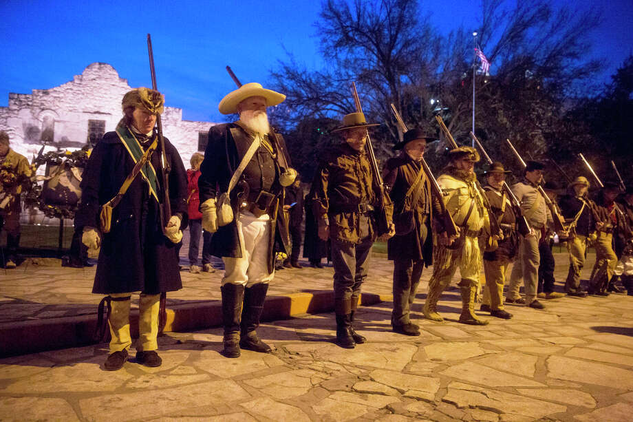 "Historical re-enactors from all over Texas and the U.S. walk in formation during the annual Dawn at the Alamo ceremony on March 6. The circuslike atmosphere that surrounds the shrine is ""difficult to look at,"" said one overseas visitor. Photo: Carolyn Van Houten / San Antonio Express-News / 2015 San Antonio Express-News"