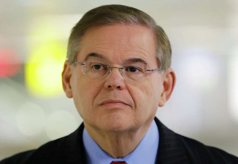 FILE - In this March 1, 2013, file photo, Sen. Robert Menendez listens during a news conference, at Newark Liberty International Airport in Newark, N.J. Attorney General Eric Holder is declining to say if he has approved the filing of corruption charges against Menendez. Nor is Menendez shedding much light on the situation. A statement issued by the senator's office Friday, March 6, 2015, says many false allegations have been made about his ties with Dr. Salomon Melgen, who is a friend and donor to Menendez's campaigns. (AP Photo/Mel Evans, File) Photo: Mel Evans, STF / AP