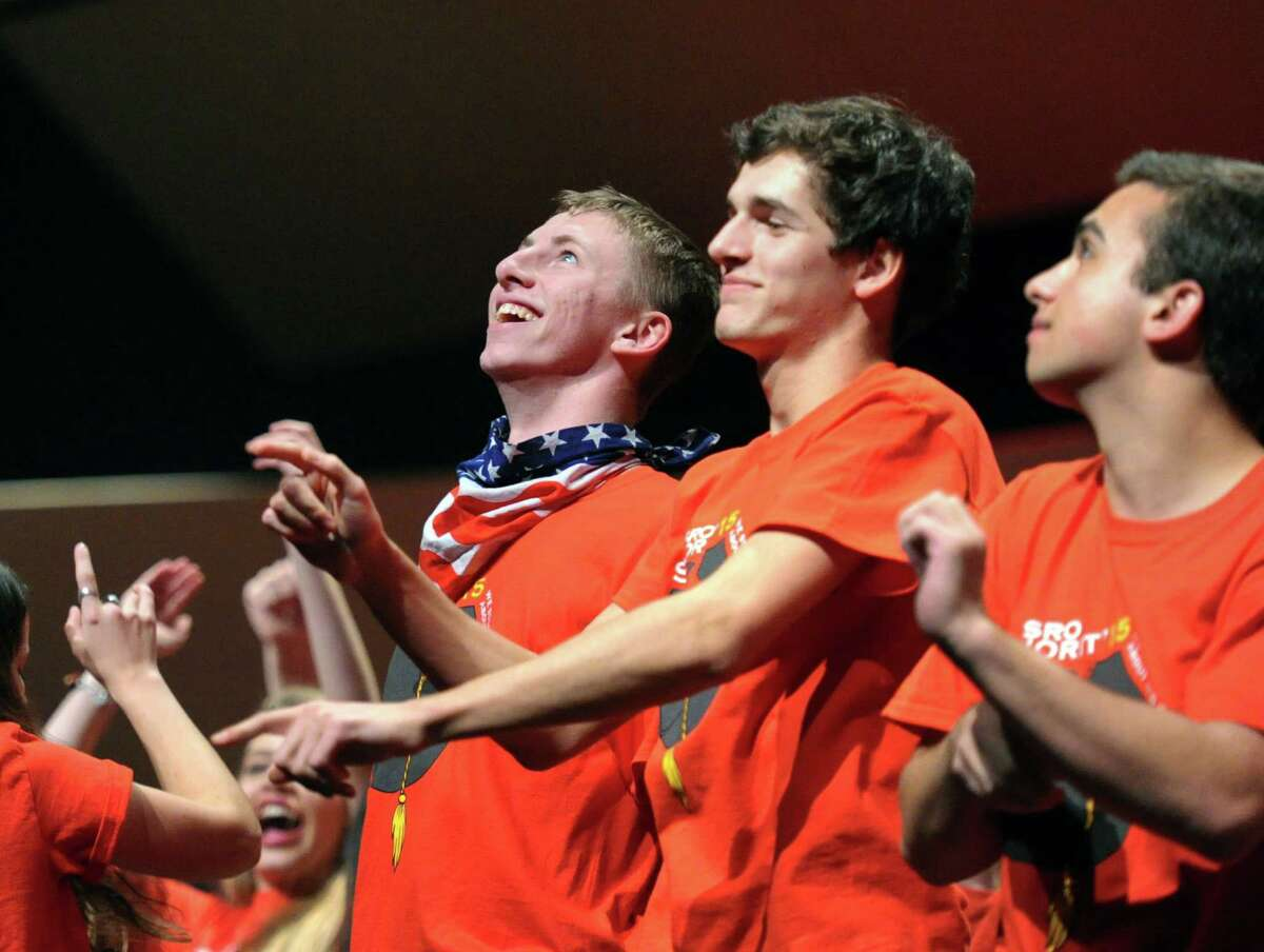 Third from right, Anthony Busani, 17, a Greenwich High School senior, performs the opening song