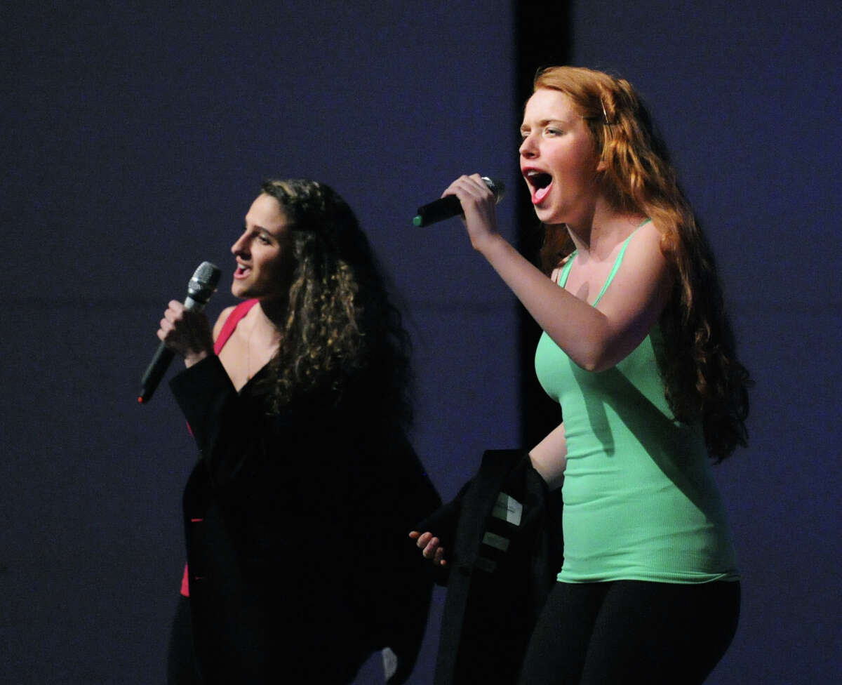 Greenwich High School seniors, Kristen Ragusa, 17, left, and Carly Polistina, also 17, perform a boy band mash-up during the senior class annual revue show, SRO, in the school's auditorium, Friday night, March 6, 2015.