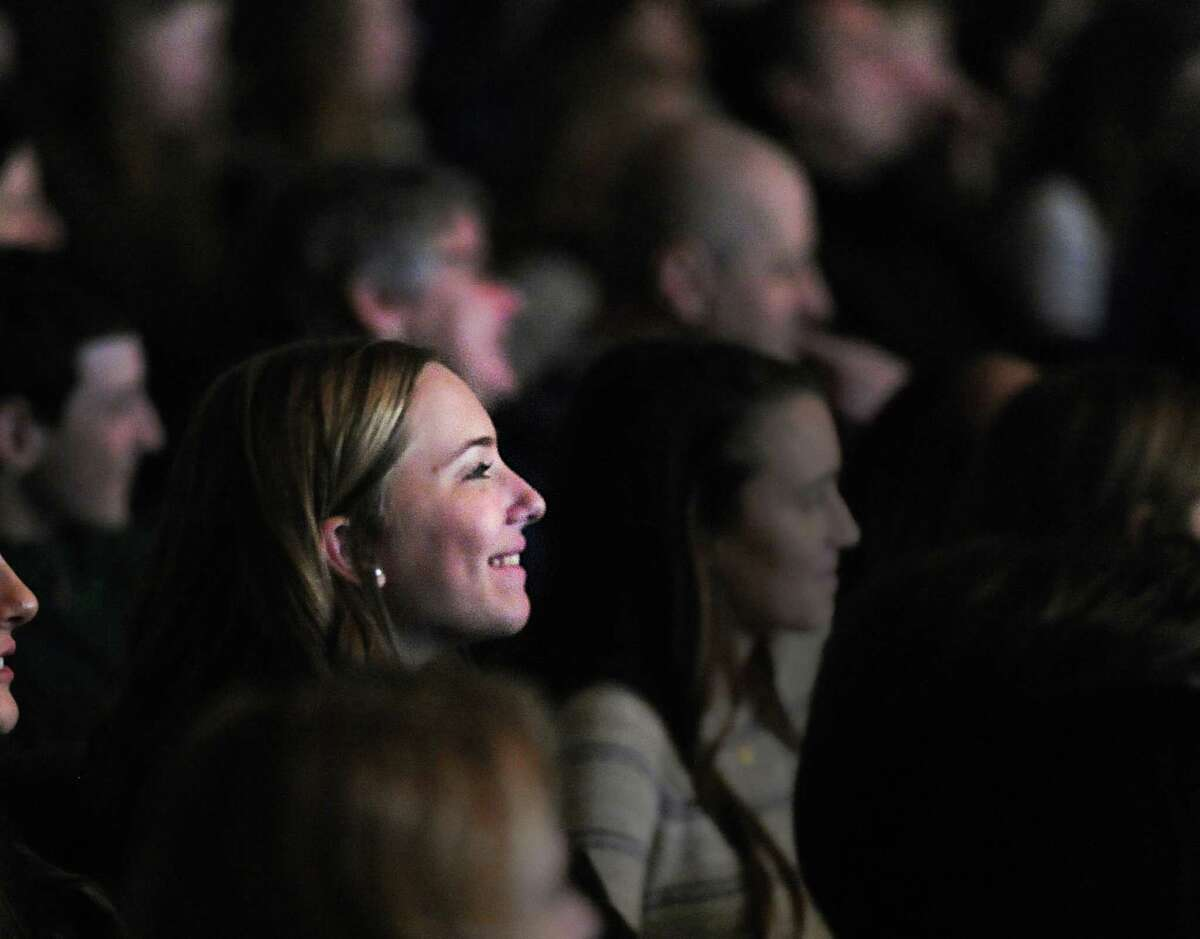 Watching from the audience, Greenwich High School senior Sarah Cinquegrana, 17, enjoys the class annual revue show, SRO, in the school's auditorium, Friday night, March 6, 2015.