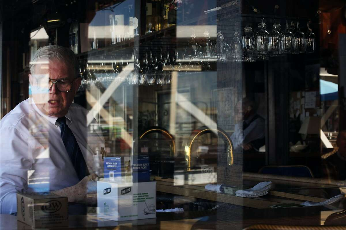 Bartender at Sinbad's Restaurant who only wants to be referred to as Mike restocks bar in San Francisco, Calif., Thursday March 5, 2015.
