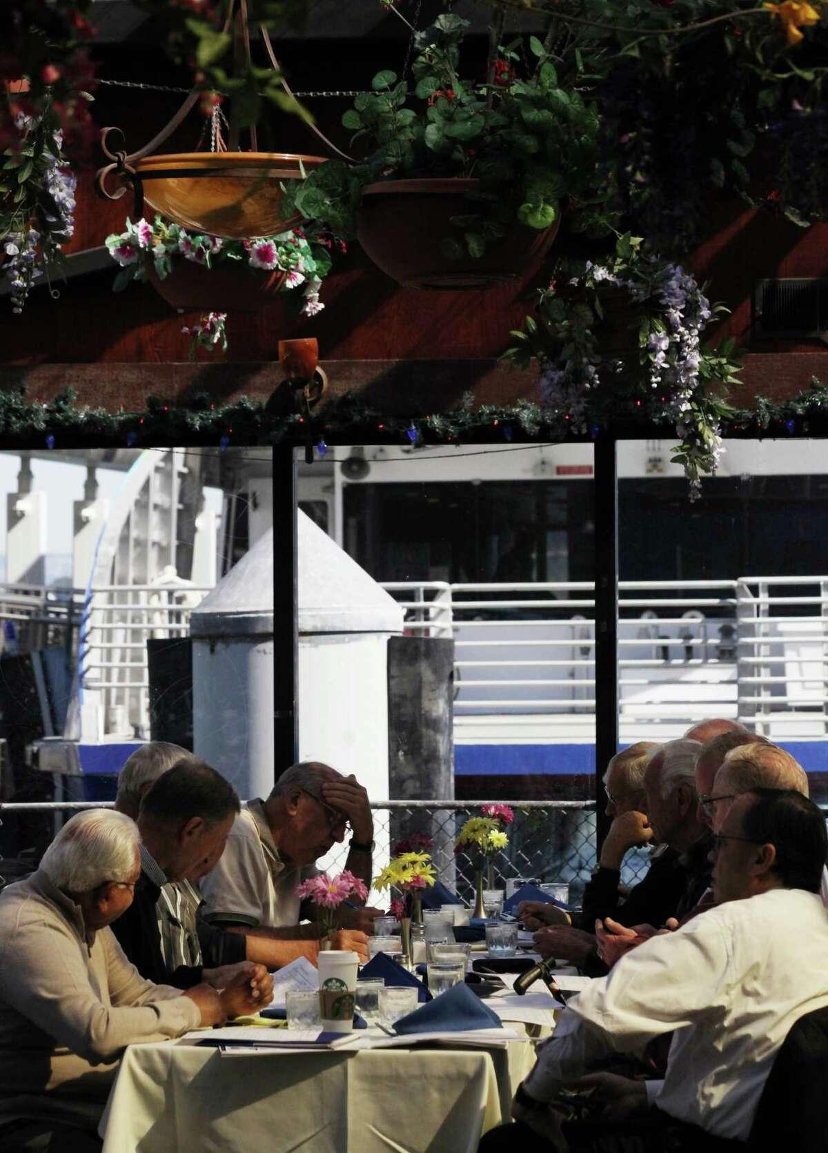 Gentlemen enjoying their lunch at Sinbad's Restaurant in San Francisco, Calif., Thursday March 5, 2015.