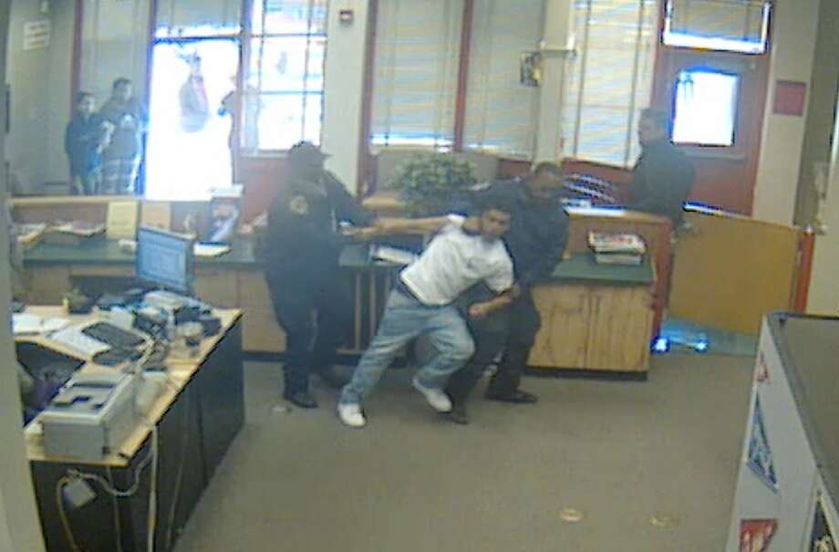 A still photo from a video from January 2014 shows school security officers at Fremont High School in Oakland using force to subdue a student.