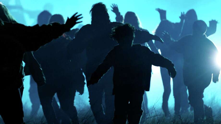 """Zombie hordes, such as these in a scene from the horror film """"Buck Wild,"""" will take longest to reach the northern Rocky Mountains in the event of a zombie apocalypse, a graduate student from Cornell University says. Photo: Courtesy Wes Dixon"""