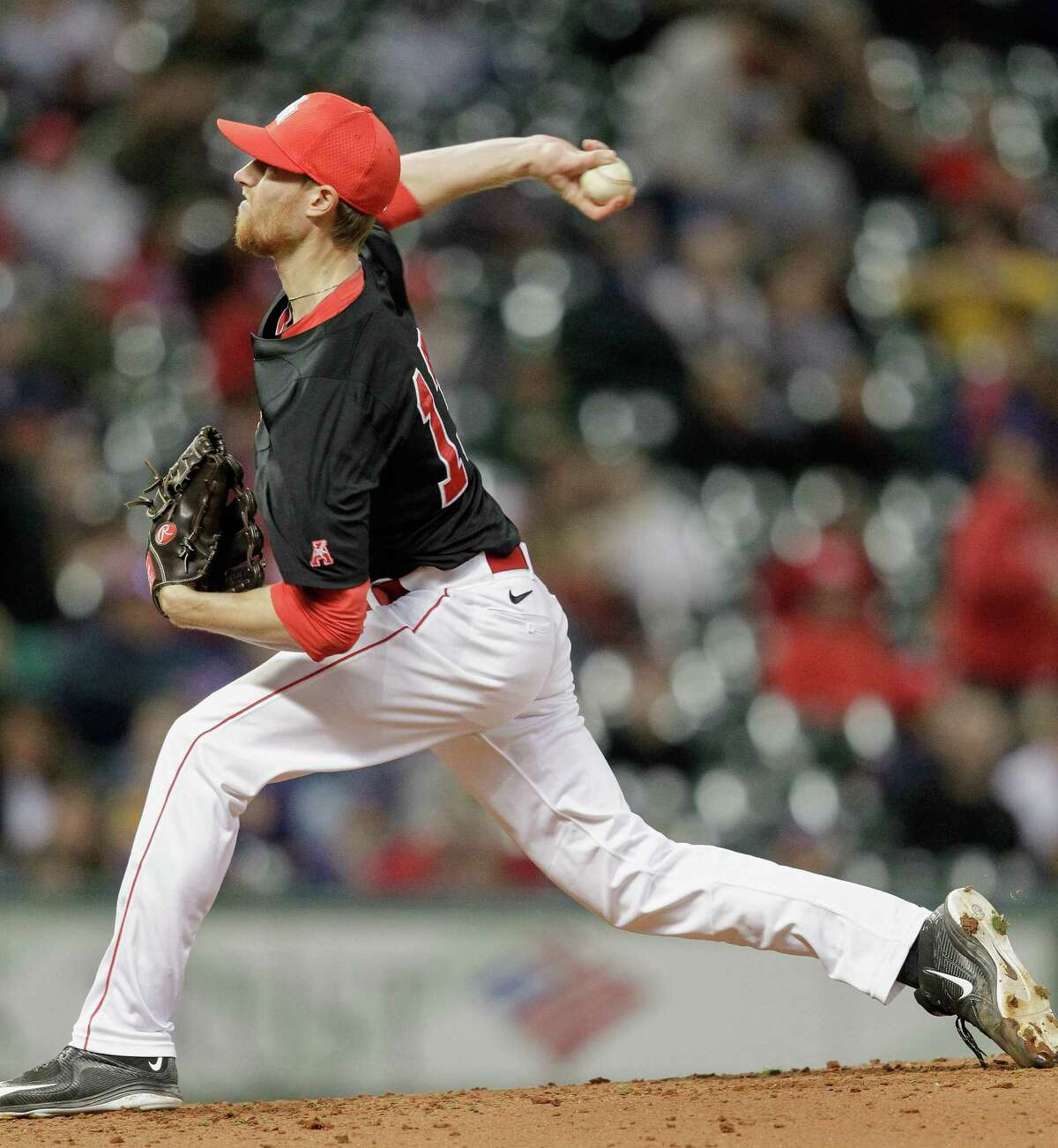 Houston pitcher Andrew Lantrip (13) throws in the first inning against the LSU Tigers during the College Classic on March 6, 2015 at Minute Maid Park in Houston, Texas.