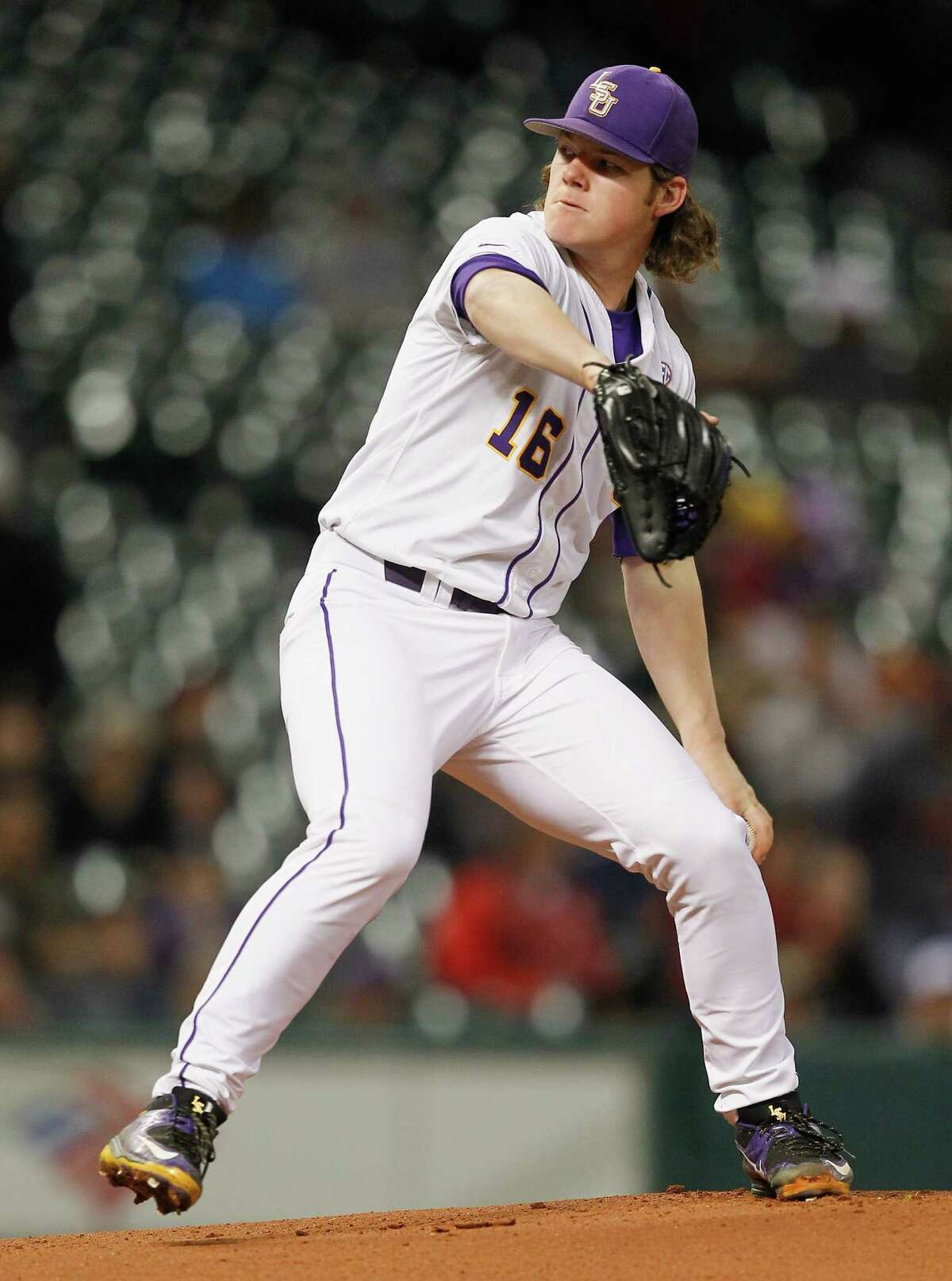 LSU pitcher Jared Poche' (16) throws against the Houston Cougars in the first inning during the College Classic on March 6, 2015 at Minute Maid Park in Houston, Texas.