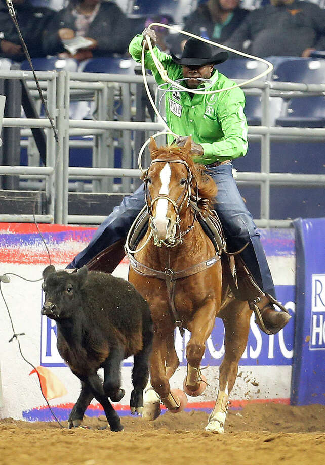 Fred Whitfield competes in the Tie-Down Roping event during the Houston Livestock Show and Rodeo at NRG Park, Friday, March 6, 2015, in Houston. Photo: Karen Warren, Houston Chronicle / © 2015 Houston Chronicle