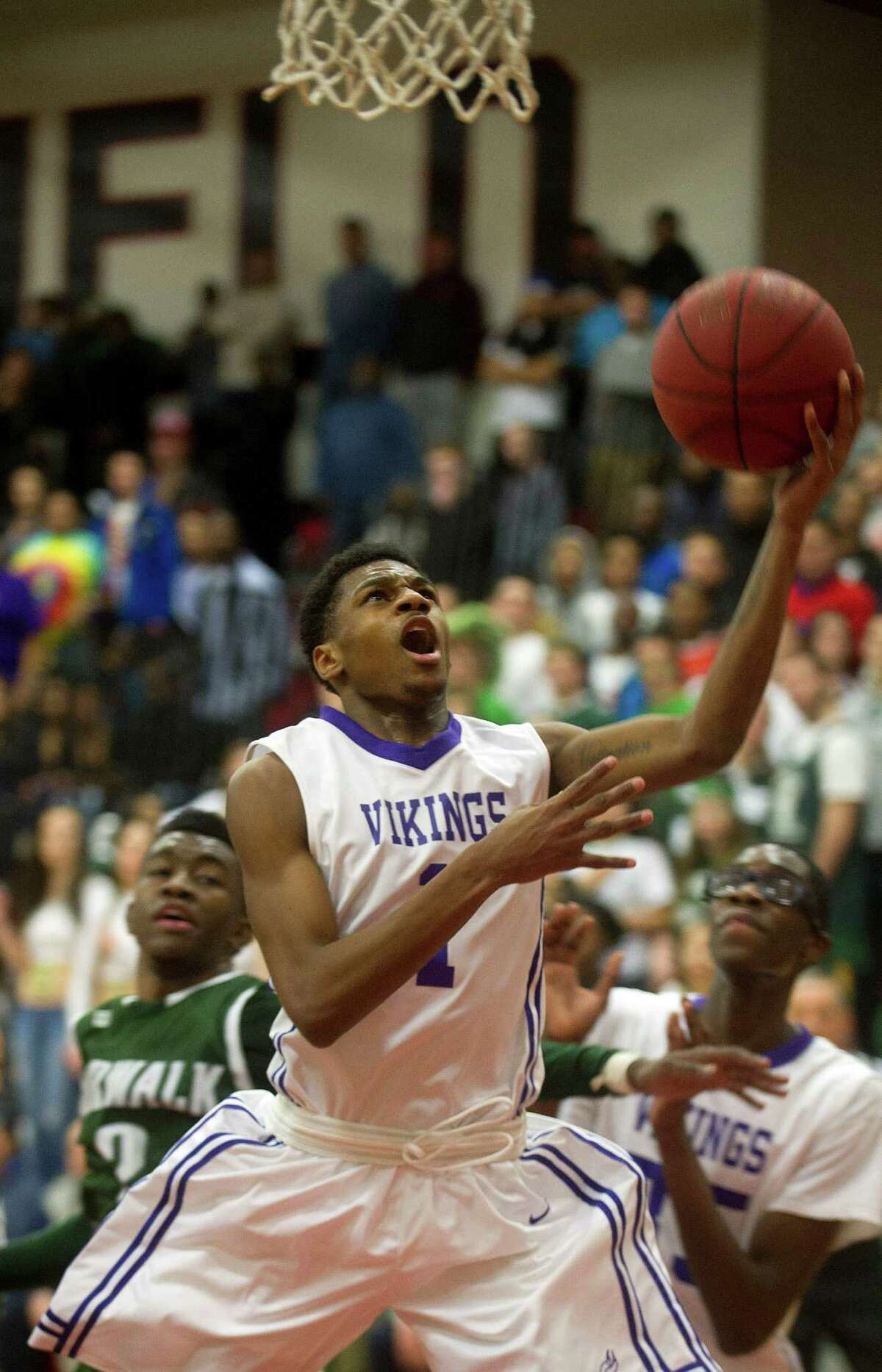 Westhill's Jeremiah Livingston takes a shot during the FCIAC Boys Basketball Championship game between Westhill and Norwalk High Schools at Fairfield Warde High School in Fairfield, Conn., on Friday, March 6, 2015.