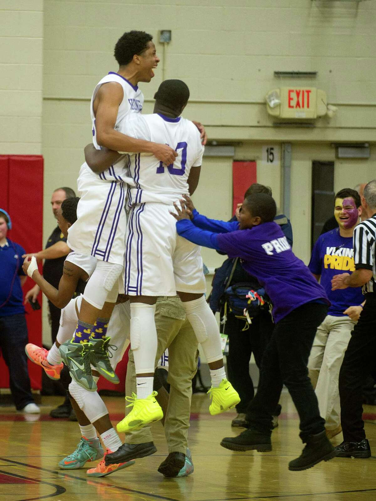 Westhill players celebrate winning Friday's FCIAC Boys Basketball Championship game between Westhill and Norwalk High Schools at Fairfield Warde High School in Fairfield, Conn., on Friday, March 6, 2015.