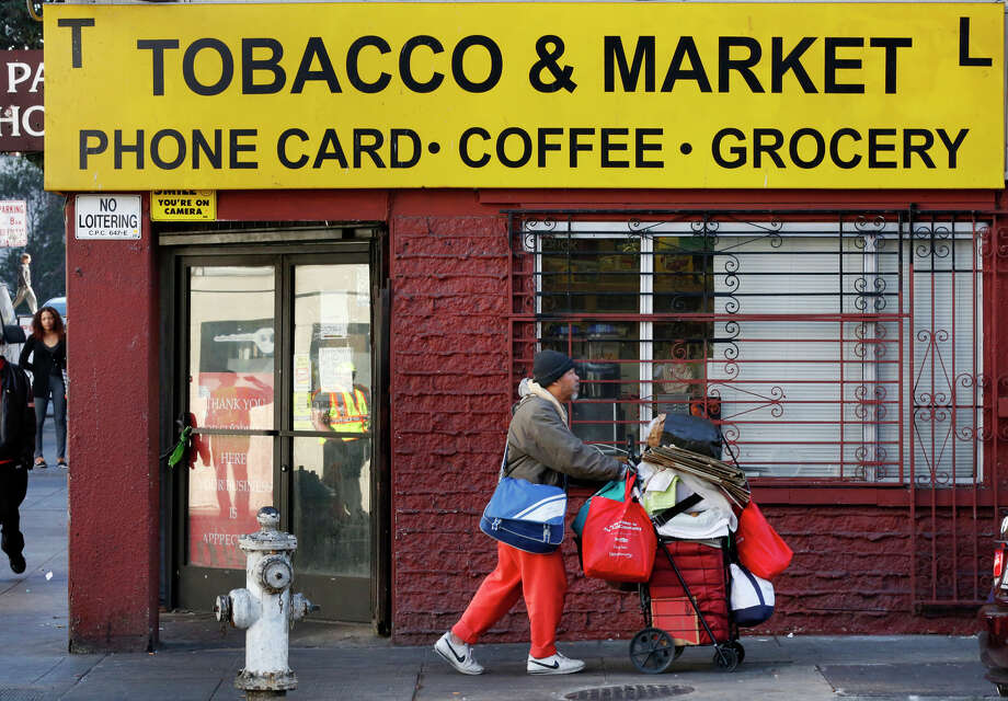 TL Tobacco & Market in the Tenderloin is one of the bad-apple corner stores that service agencies have been in conflict with over their cozy relationship with street thugs. Photo: Leah Millis / The Chronicle / ONLINE_YES