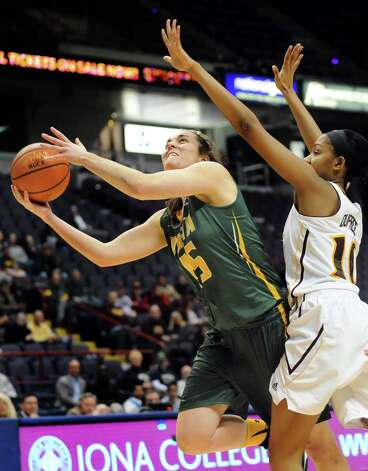 Siena's Meghan Donohue, center, shoots for the hoop as Iona's Karynda DuPree defends during their quarterfinal game in the MAAC Championship on Friday, March 6, 2015, at Times Union Center in Albany, N.Y. (Cindy Schultz / Times Union) Photo: Cindy Schultz / 10030865A