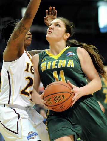 Siena's Margot Hetzke, right, goes to the hoop as Iona's Joy Adams defends during their quarterfinal game in the MAAC Championship on Friday, March 6, 2015, at Times Union Center in Albany, N.Y. (Cindy Schultz / Times Union) Photo: Cindy Schultz / 10030865A