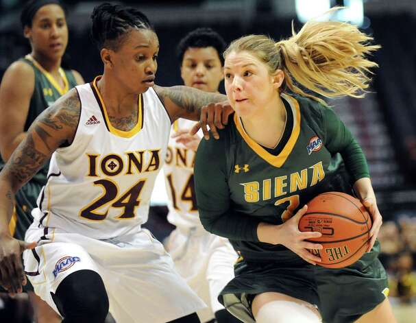 Siena's Ida Krogh, right, goes to the hoop as Iona's Joy Adams defends during their quarterfinal game in the MAAC Championship on Friday, March 6, 2015, at Times Union Center in Albany, N.Y. (Cindy Schultz / Times Union) Photo: Cindy Schultz / 10030865A