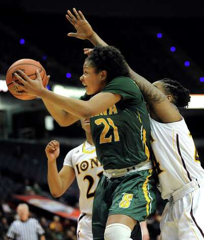 Siena's Kollyns Scarbrough, left, goes to the hoop as Iona's Joy Adams defends during their quarterfinal game in the MAAC Championship on Friday, March 6, 2015, at Times Union Center in Albany, N.Y. (Cindy Schultz / Times Union) Photo: Cindy Schultz / 10030865A