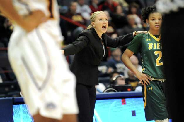 Siena's coach Ali Jaques, center, instructs her team as she gets ready to put Kollyns Scarbrough in the game during their quarterfinal game in the MAAC Championship against Iona on  Friday, March 6, 2015, at Times Union Center in Albany, N.Y. (Cindy Schultz / Times Union) Photo: Cindy Schultz / 10030865A