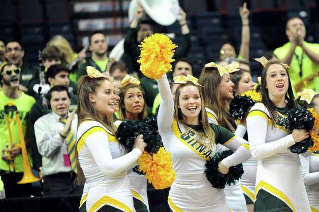 Siena's cheerleaders and pep band celebrate their 71-61 win over Iona in their quarterfinal game in the MAAC Championship on Friday, March 6, 2015, at Times Union Center in Albany, N.Y. (Cindy Schultz / Times Union) Photo: Cindy Schultz / 10030865A