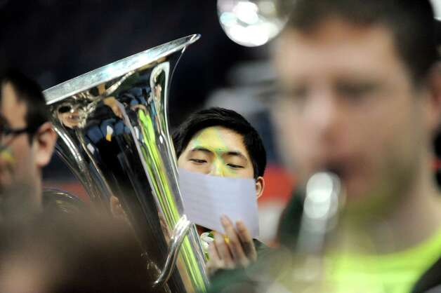 Siena's pep band tuba player Asaph Ko, 18, keeps an eye on the music during their quarterfinal game against Iona in the MAAC Championship on Friday, March 6, 2015, at Times Union Center in Albany, N.Y. (Cindy Schultz / Times Union) Photo: Cindy Schultz / 10030865A