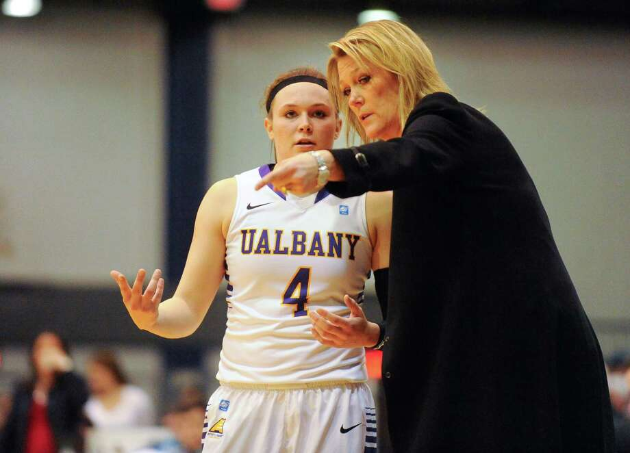 UAlbany head coach Katie Abrahamson-HendersonÊinstructs  SarahRoyals (4) against Hartford's during the second half of an NCAA college basketball game at the SEFCU Arena in Albany, N.Y., Sunday, Jan. 25, 2015. (Hans Pennink / Special to the Times Union) ORG XMIT: HP106 Photo: Hans Pennink / 00030300A