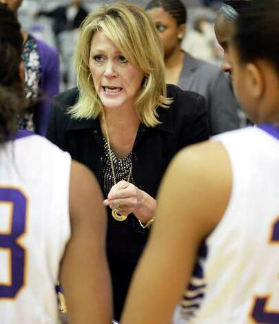 UAlbany women's head coach Katie Abrahamson-Henderson, center, with players during Saturday's game against UMass-Lowell at the SEFCU Arena Feb. 7, 2015, in Albany, NY.  (John Carl D'Annibale / Times Union) Photo: John Carl D'Annibale / 10030492A