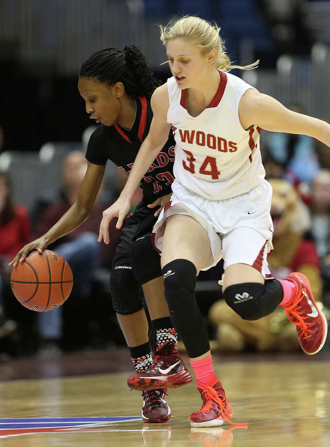 San Antonio Wagner's Kiana Williams keeps the ball away from Houston Cypress Woods' Cate Reese during first half of the UIL GirlâÄôs Basketball 6A State semifinals at the Alamodome, Friday, March 6, 2015 Photo: JERRY LARA, San Antonio Express-News / © 2015 San Antonio Express-News