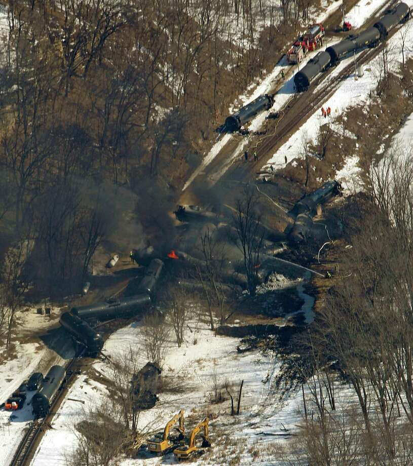 Railcars continue to burn at the scene of a freight train derailment south of Galena, Ill., on Friday, March 6, 2015.  No injuries were reported, but the accident was the latest in a series of failures for the safer tank-car model that has led some people calling for even tougher requirements.  (AP Photo/Telegraph Herald, Mike Burley)   MAGS OUT, TV OUT,  MANDATORY CREDITRailcars continue to burn at the scene of a freight train derailment south of Galena, Ill., on Friday, March 6, 2015.  No injuries were reported, but the accident was the latest in a series of failures for the safer tank-car model that has led some people calling for even tougher requirements.  (AP Photo/Telegraph Herald, Mike Burley)   MAGS OUT, TV OUT,  MANDATORY CREDIT Photo: Mike Burley, MBO / Telegraph Herald