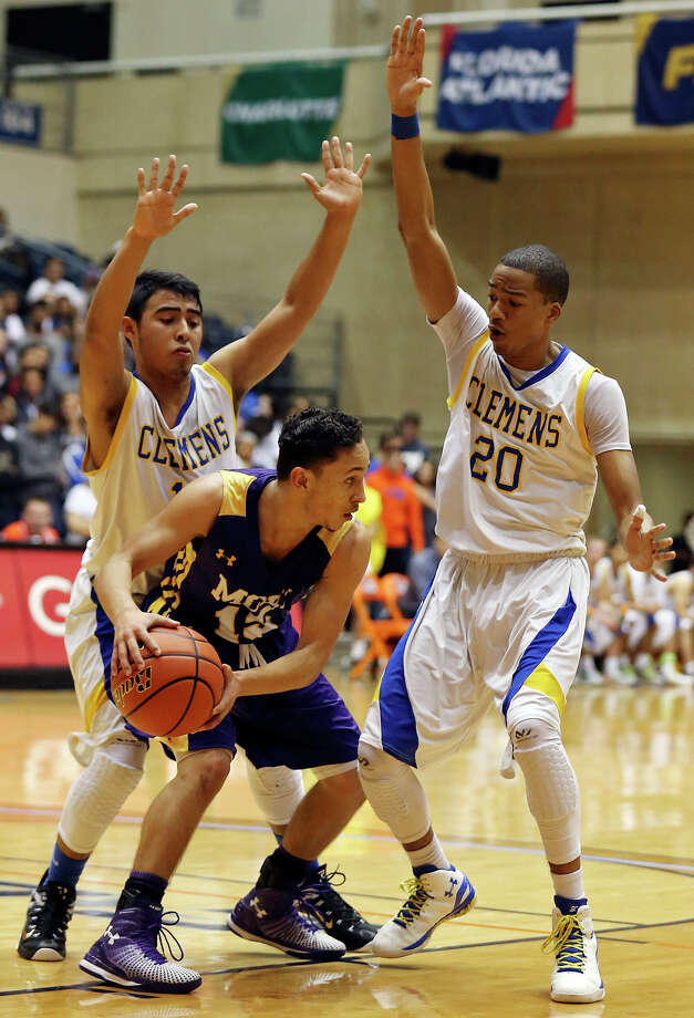 Clemens' Ernesto Castillo (left) and Darrell Harris defend McAllen's Joan Lopez during first half action of their Region IV-6A semifinal game held Friday March 6, 2015 at the UTSA Convocation Center. Photo: Edward A. Ornelas, Staff / San Antonio Express-News / © 2015 San Antonio Express-News