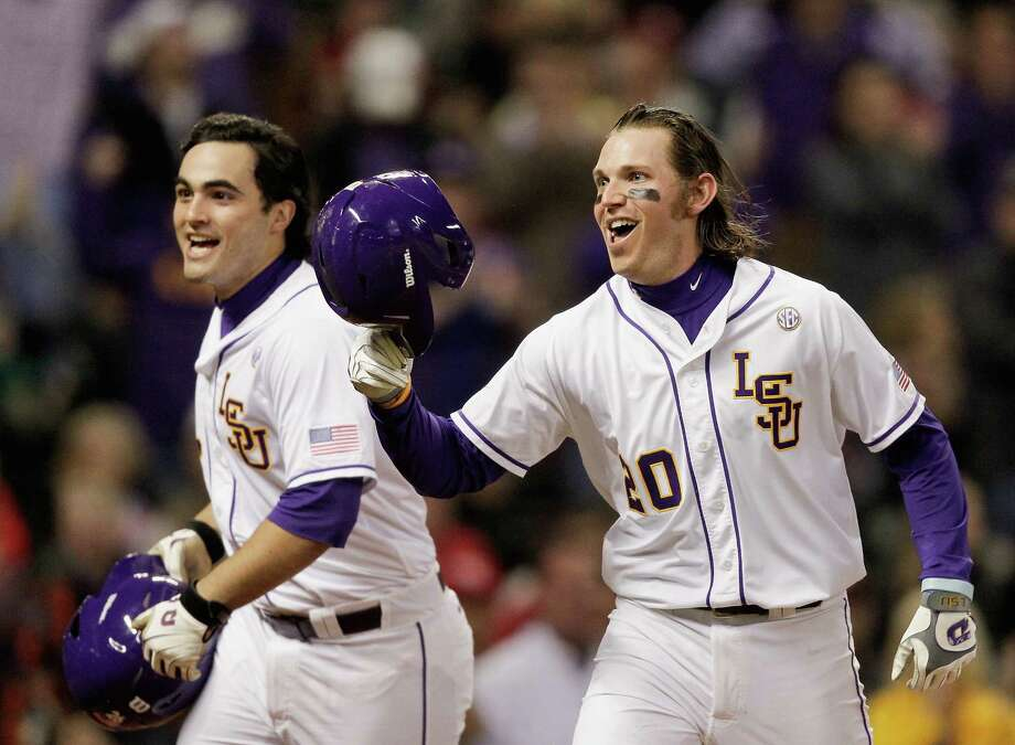 LSU's Conner Hale, right, celebrates with Chris Chinea after hitting a two-run homer in the first inning of the Tigers' 4-2 victory over Houston in the Houston College Classic at Minute Maid Park on Friday night. Photo: Bob Levey, Photographer / ©2015 Bob Levey