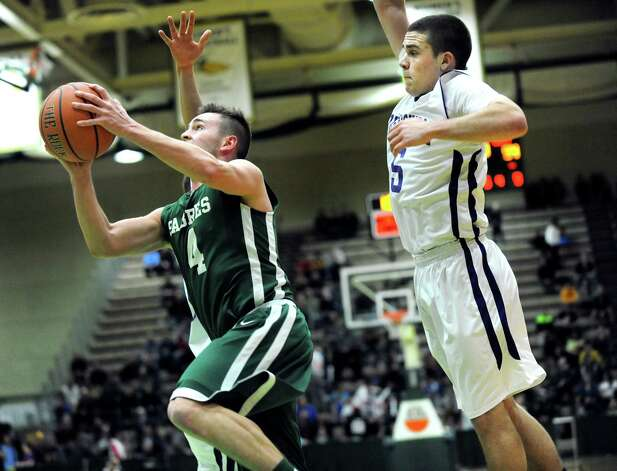 Schalmont's Aidan Frank, left, goes to the hoop as Voorheesville's Shane Parry defends during their Class B boys basketball semifinals on Friday, March 6, 2015, at Hudson Valley Community College in Troy, N.Y. (Cindy Schultz / Times Union) Photo: Cindy Schultz / 10030880A