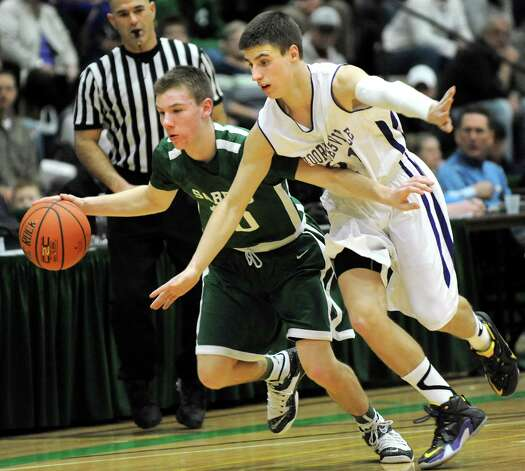 Schalmont's Tyler Mattice, left, controls the ball as Voorheesville's Robert Denman defends during their Class B boys basketball semifinals on Friday, March 6, 2015, at Hudson Valley Community College in Troy, N.Y. (Cindy Schultz / Times Union) Photo: Cindy Schultz / 10030880A