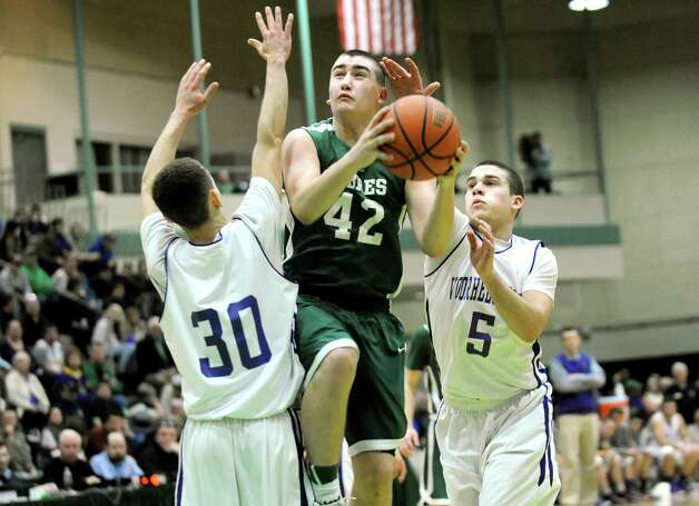 Schalmont's Josh Clifford, center, goes to the hoop as Voorheesville's Isaiah Meaux, left, and Shane Parry defend during their Class B boys basketball semifinals on Friday, March 6, 2015, at Hudson Valley Community College in Troy, N.Y. (Cindy Schultz / Times Union) Photo: Cindy Schultz / 10030880A