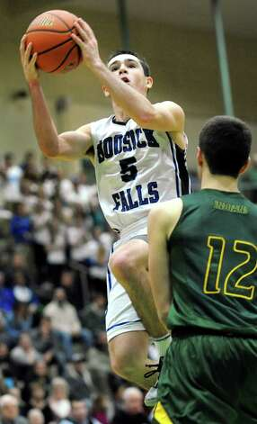 Hoosick Falls' Andrew Hoag, left, goes to the hoop as Ravena's Sky Rebeor defends during their Class B boys basketball semifinals on Friday, March 6, 2015, at Hudson Valley Community College in Troy, N.Y. (Cindy Schultz / Times Union) Photo: Cindy Schultz / 10030880A