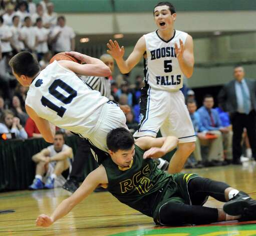 Hoosick Falls' Andrew Hoag, right, yells for the balls when Connor McCart, center, collides with Ravena's Sky Rebeor during their Class B boys basketball semifinals on Friday, March 6, 2015, at Hudson Valley Community College in Troy, N.Y. (Cindy Schultz / Times Union) Photo: Cindy Schultz / 10030880A