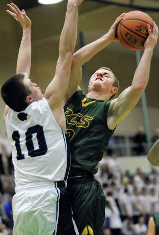 Ravena's David Warnken, right, goes to the hoop as Hoosick Falls' Connor McCart defends during their Class B boys basketball semifinals on Friday, March 6, 2015, at Hudson Valley Community College in Troy, N.Y. (Cindy Schultz / Times Union) Photo: Cindy Schultz / 10030880A