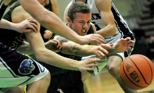 Ravena's David Warnken, center, dives for a loose ball during their Class B boys basketball semifinals against Hoosick Falls on Friday, March 6, 2015, at Hudson Valley Community College in Troy, N.Y. (Cindy Schultz / Times Union) Photo: Cindy Schultz / 10030880A