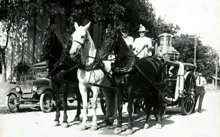 Following the mechanization of San Antonio Fire Department vehicles, Fire Chief Phil Wright drives the city's last horse-drawn engine away from Fire Station No. 5 on April 4, 1927. Photo: Courtesy Photo / San Antonio Fire Museum / Copyright (C) reserved