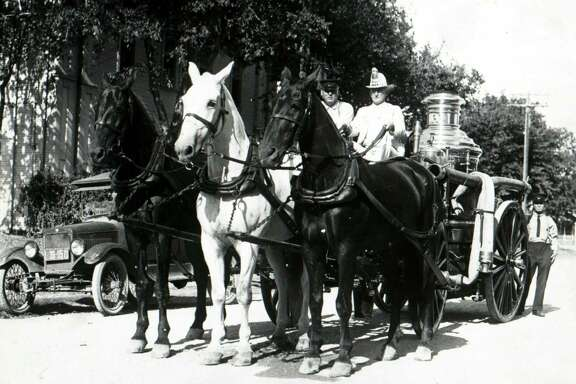 Following the mechanization of San Antonio Fire Department vehicles, Fire Chief Phil Wright drives the city's last horse-drawn engine away from Fire Station No. 5 on April 4, 1927.