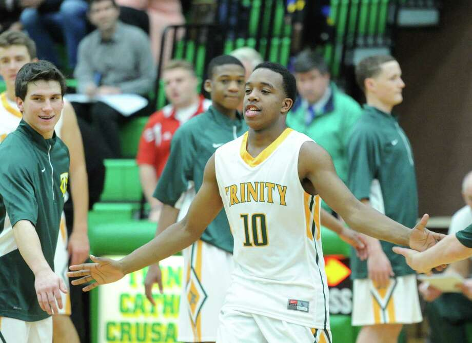 Trinity Catholic's Tyrell St. John is averaging 25 points per game this season. Photo: Bob Luckey / Greenwich Time