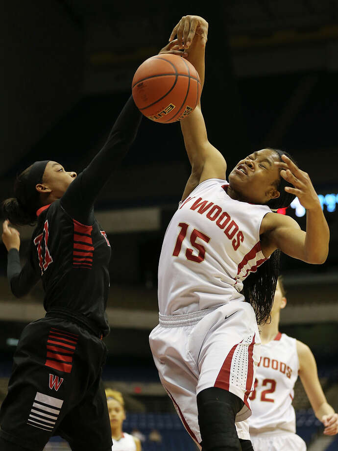 Houston Cypress Woods' Jasmine Williams grabs the rebound against San Antonio Wagner's Dessiere Johnson during first half of the UIL Girl's Basketball 6A State semifinals at the Alamodome, Friday, March 6, 2015 Photo: JERRY LARA, Staff / San Antonio Express-News / © 2015 San Antonio Express-News