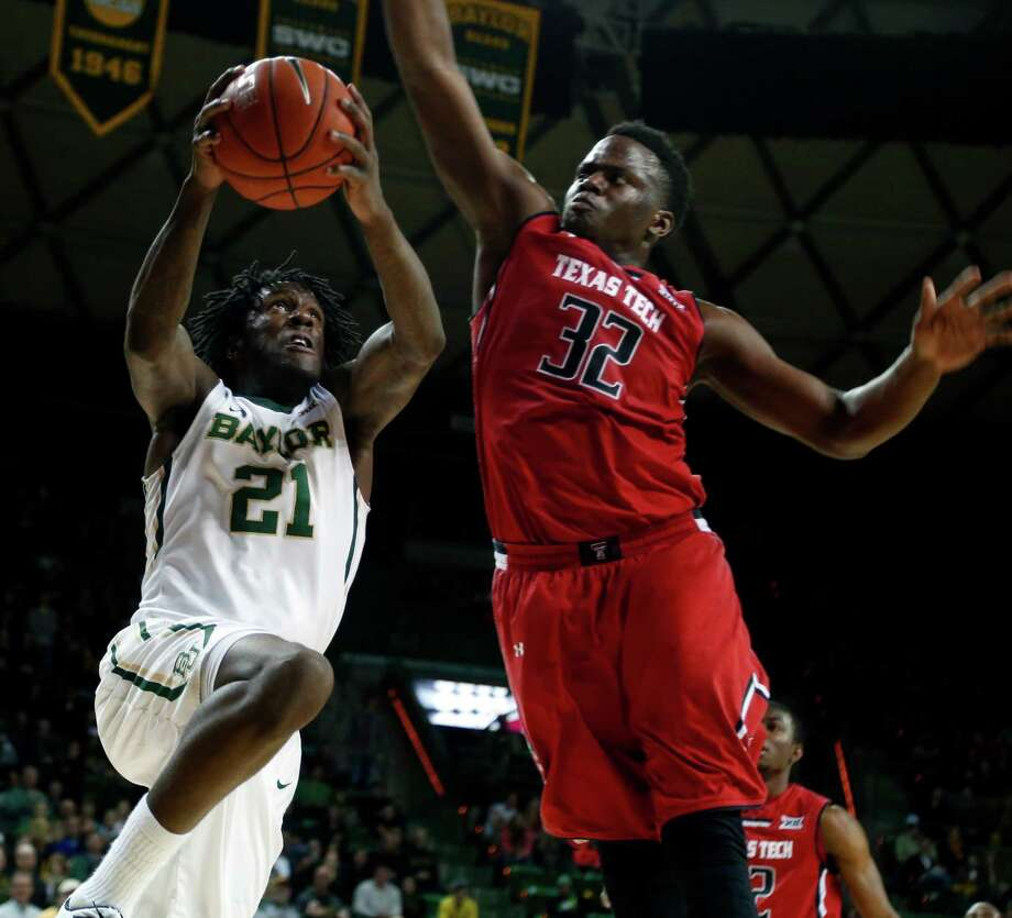 Baylor forward Taurean Prince (21) drives against Texas Tech forward Norense Odiase, right, in the second half of an NCAA college basketball game, Friday, March, 6, 2015, in Waco, Texas. Baylor won 77-74. (AP Photo/Jerry Larson) Photo: Jerry Larson, FRE / Associated Press / FR91203 AP